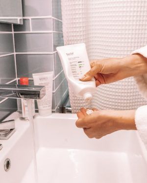 belif cream cleanser squeezed into palm of hand