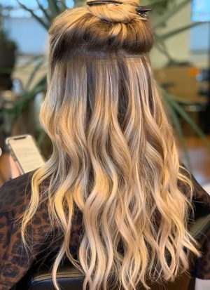 how much do tape in hair extensions cost