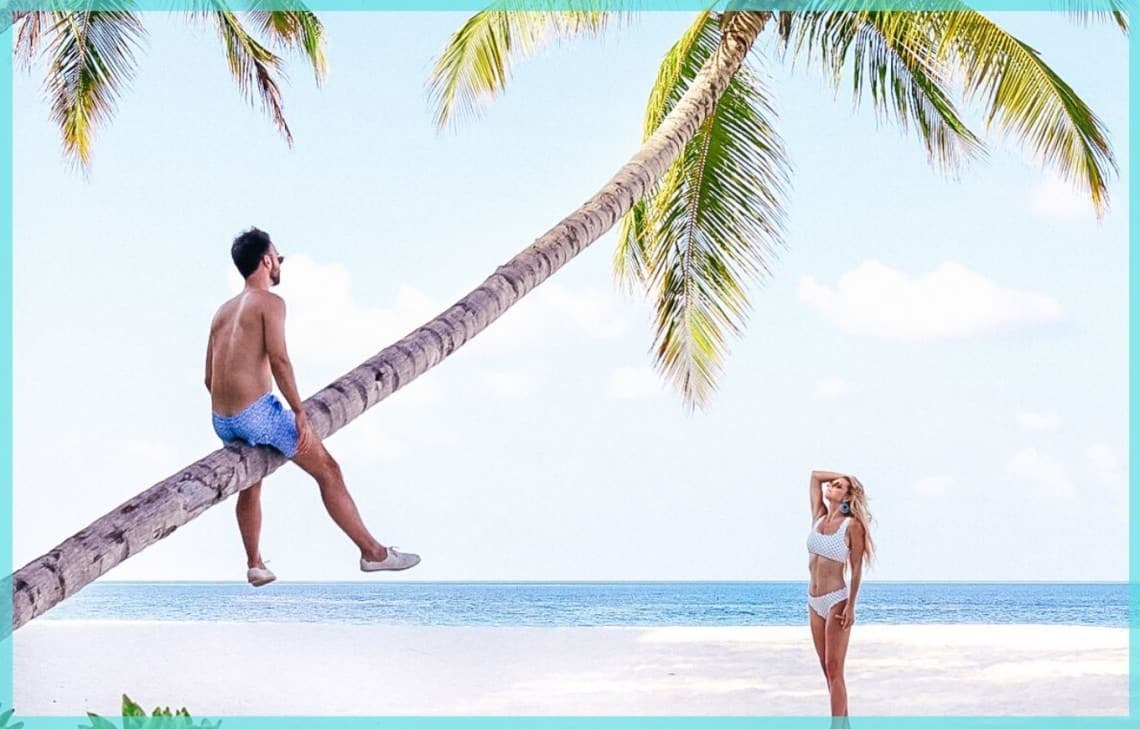 couple in the maldives with palm tree