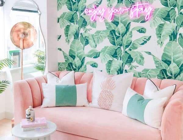 lindsay silberman blogger home office palm wallpaper neon sign pink couch