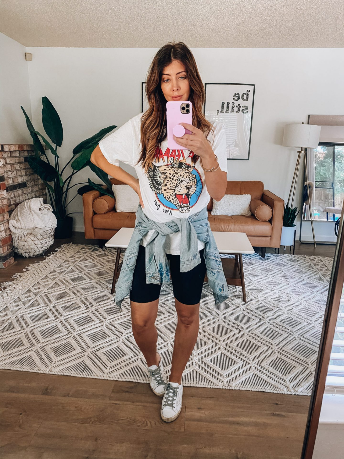 white sneakers with bike shorts and band tee