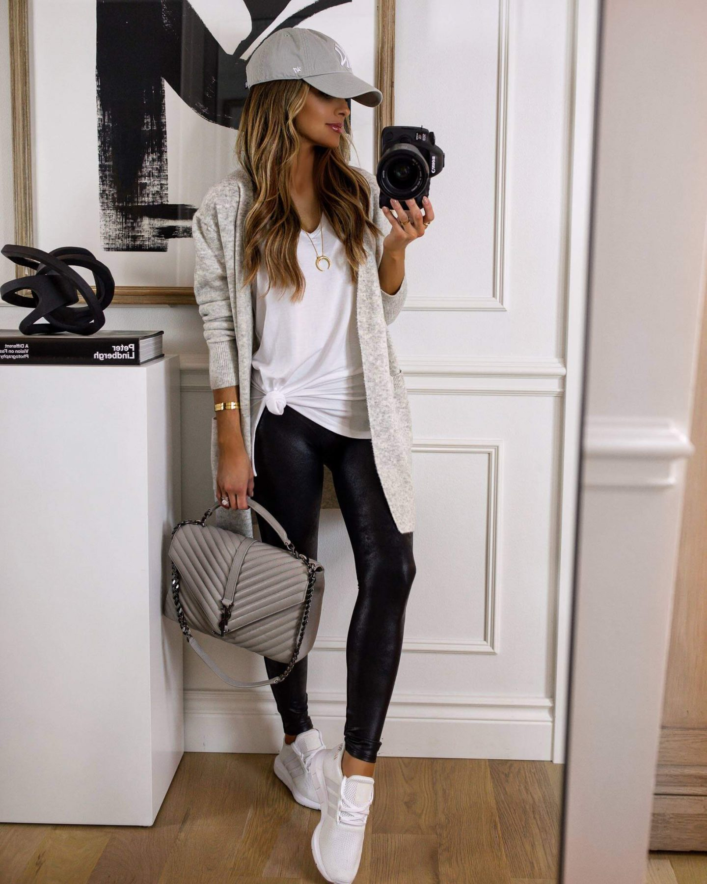 leggings and long cardigan and white sneakers